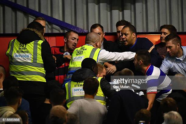Queens Park Rangers fans fights between themselves during the Sky Bet Championship match between Queens Park Rangers and Brentford at Loftus Road on...