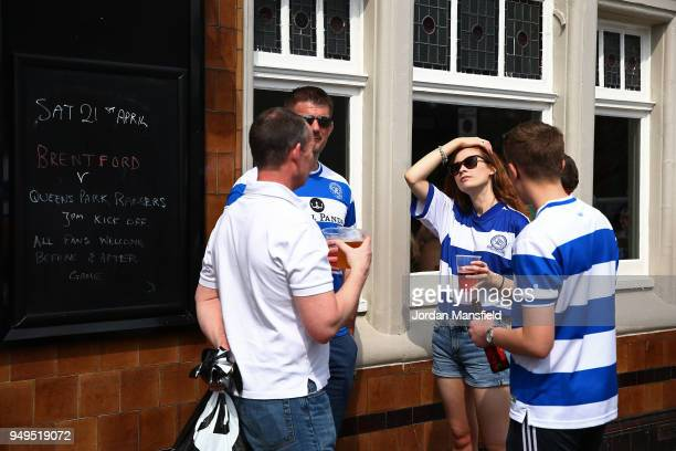 Queens Park Rangers fans wait outside the ground prior to the Sky Bet Championship match between Brentford and Queens Park Rangers at Griffin Park on...