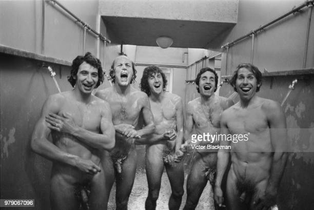 Queens Park Rangers FC players singing together while taking a shower, UK, 20th March 1974; L-R: Dave Clement, Terry Mancini, Don Givens, Frank...