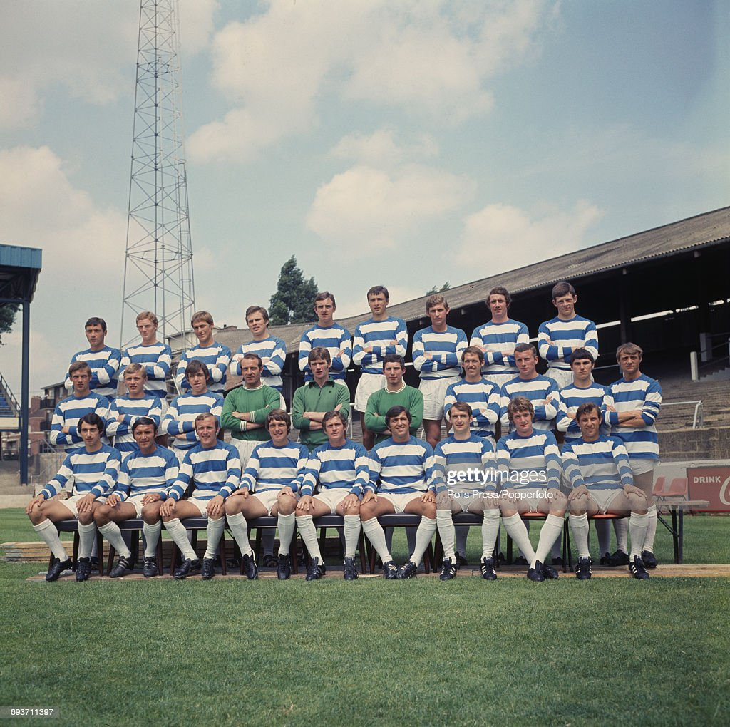 Queens Park Rangers Football Club squad posed together on the pitch at Loftus Road Stadium in London on 14th July 1969 prior to the start of the 1969-70 season. The team are, back row from left to right: Bob Turpie, Alan Collman, Eddie Lane, Bob Finch, Mick Busby, Ian Evans, Frank Sibley, Alan Wilks and Ian Gillard. Middle row from left to right: Joe Nixon, Steve Tom, Tony Hazell, Ron Springett, Mike Kelly, Alan Spratley, Mick Leach, Mick McGovern, Gerry Francis and Clive Clark. Front row from left to right: Dave Clement, Barry Bridges, Alan Harris, Ron Hunt, Dave Metchick, Terry Venables, Frank Clark, Rodney Marsh and Ian Watson.
