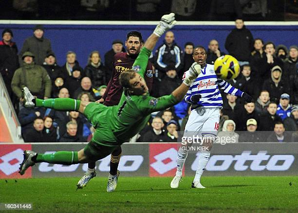 Queens Park Rangers' French striker Loic Remy watches his shot go wide of Manchester City's English goalkeeper Joe Hart during the English Premier...
