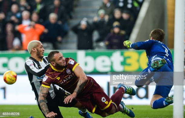 Queens Park Rangers Goalkeeper Alex Smithies fly's in the air as he hits the ball away from Yoan Gouffran of Newcastle United during the Sky Bet...