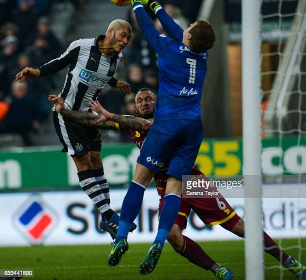 Queens Park Rangers Goalkeeper Alex Smithies hits the ball away from Yoan Gouffran of Newcastle United during the Sky Bet Championship match between...