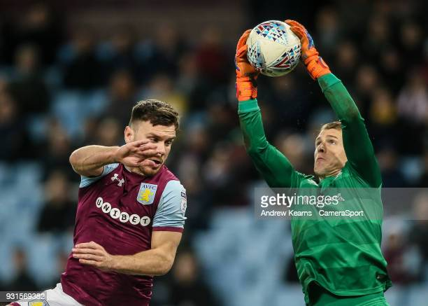 Queens Park Rangers' goalkeeper Alex Smithies saves under pressure from Aston Villa's Scott Hogan during the Sky Bet Championship match between Aston...