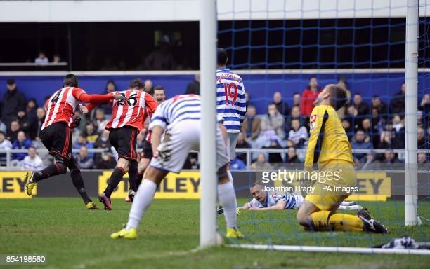 Queens Park Rangers' goalkeeper Robert Green and Clint Hill appear dejected after Sunderland's Steven Fletcher scores the opening goal of the game