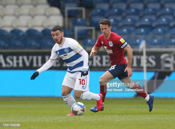 Queens Park Rangers' Ilias Chair and Huddersfield Town's Jonathan Hogg during the Sky Bet Championship match between Queens Park Rangers and...