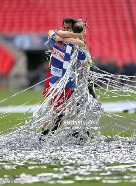 Queens Park Rangers' Joey Barton celebrates with teammate Clint Hill after the game