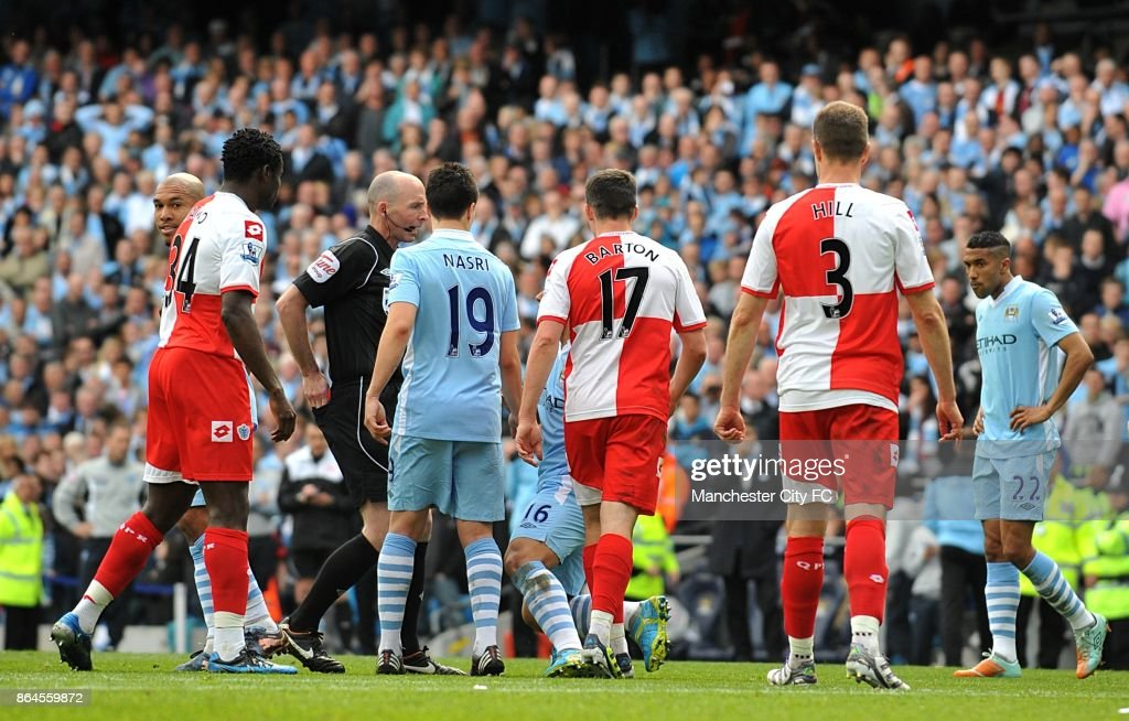 Queens Park Rangers' Joey Barton clashes with Manchester City's Sergio Aguero after being sent offl.