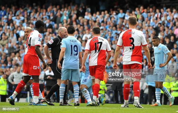 Queens Park Rangers' Joey Barton clashes with Manchester City's Sergio Aguero after being sent offl