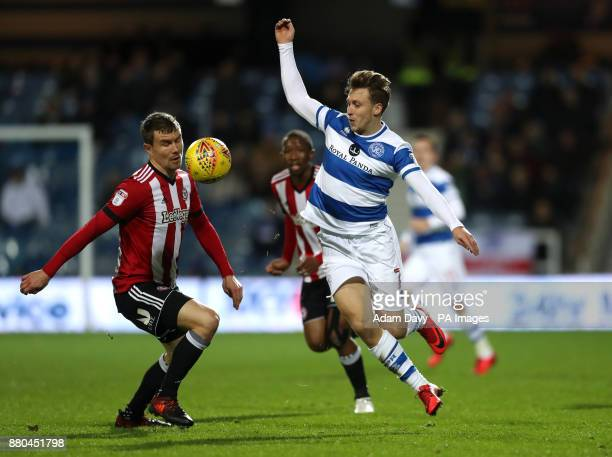 Queens Park Rangers' Luke Freeman and Brentford's Andreas Bjelland battle for the ball during the Sky Bet Championship match at Loftus Road London