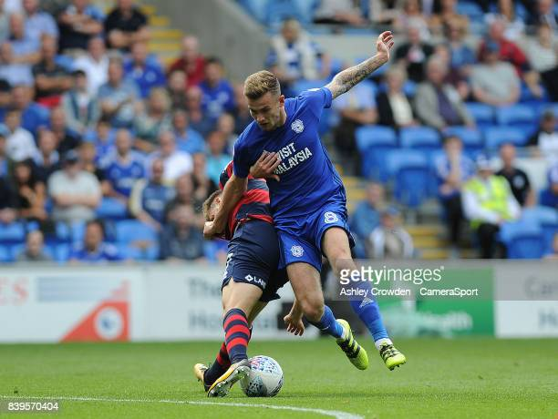 Queens Park Rangers' Luke Freeman vies for possession with Cardiff City's Joe Ralls during the Sky Bet Championship match between Cardiff City and...