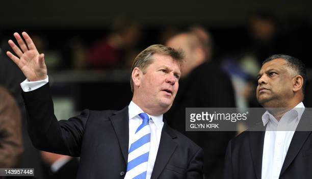 Queens Park Rangers' Malaysian Chairman Tony Fernandes and CEO Philip Beard talk before the English Premier League football match between Queens Park...