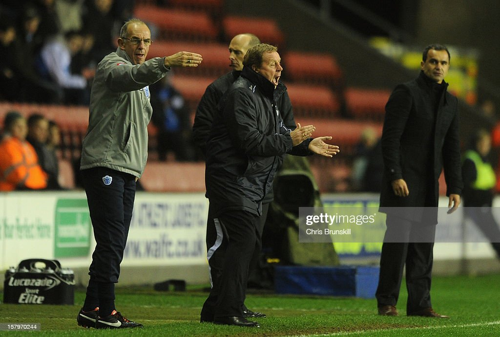 Queens Park Rangers Manager Harry Redknapp and Assistant Joe Jordan (l) issue instructions during the Barclays Premier League match between Wigan Athletic and Queens Park Rangers at the DW Stadium on December 8, 2012 in Wigan, England.