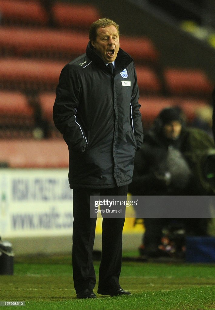 Queens Park Rangers Manager Harry Redknapp shouts orders during the Barclays Premier League match between Wigan Athletic and Queens Park Rangers at the DW Stadium on December 8, 2012 in Wigan, England.