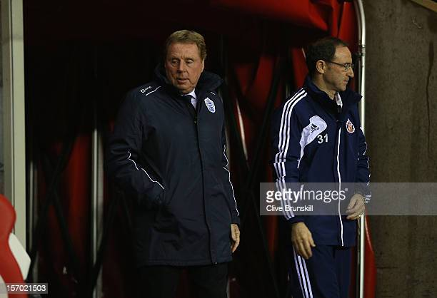 Queens Park Rangers manager Harry Redknapp walks out for his first match in charge with Sunderland manager Martin O'Neil during the Barclays Premier...