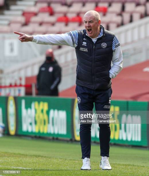 Queens Park Rangers manager Mark Warburton shouts instructions to his team from the technical area during the Sky Bet Championship match between...