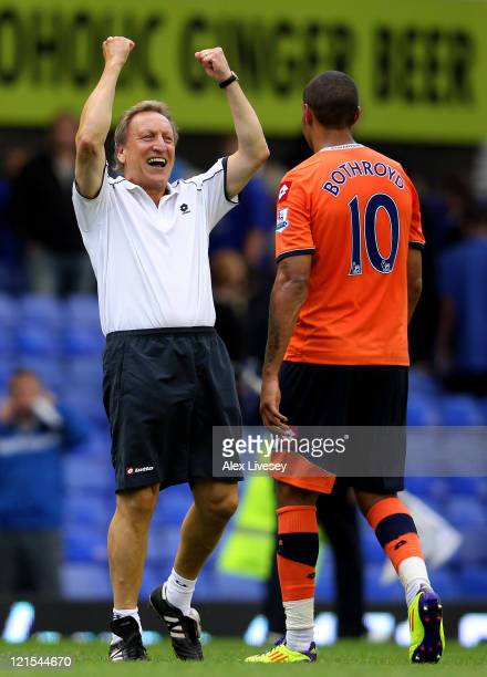 Queens Park Rangers Manager Neil Warnock celebrates at the end of the Barclays Premier League match between Everton and Queens Park Rangers at...