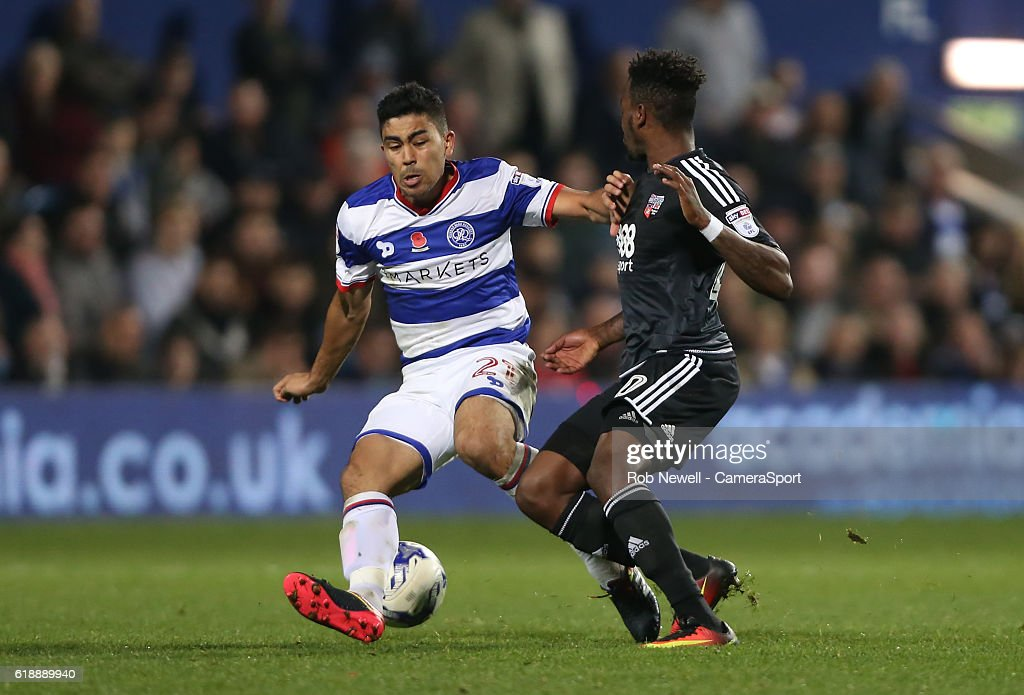 Queens Park Rangers' Massimo Luongo and Brentford's Josh Clarke during the Sky Bet Championship match between Queens Park Rangers and Brentford at Loftus Road on October 28, 2016 in London, England.