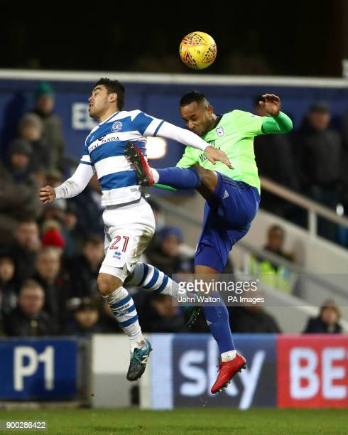Queens Park Rangers' Massimo Luongo battles for possession of the ball in the air with Cardiff City's Loic Damour during the Sky Bet Championship...