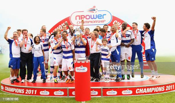 Queens Park Rangers players celebrates with the trophy after winning the npower Championship match between Queens Park Rangers and Leeds United at...
