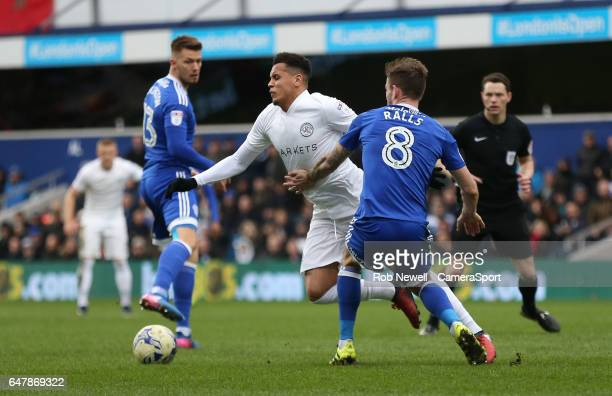 Queens Park Rangers' Ravel Morrison is brought down by Cardiff City's Joe Ralls during the Sky Bet Championship match between Queens Park Rangers and...