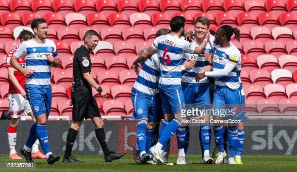 Queens Park Rangers' Rob Dickie celebrates scoring the opening goal with teammates during the Sky Bet Championship match between Middlesbrough and...