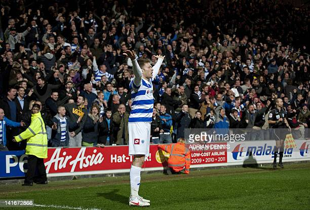 Queens Park Rangers' Scottish striker Jamie Mackie gestures to the crowd after scoring the winning goal of the English Premier League football match...