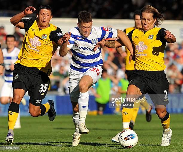 Queens Park Rangers' Scottish striker Jamie Mackie vies with Blackburn Rovers' English midfielder Jason Lowe and Spanish defender Michel Salgado...