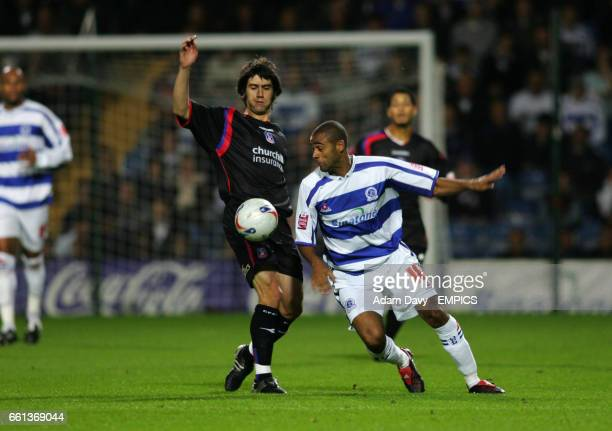Queens Park Rangers' Stefan Moore and Crystal Palace's Danny Butterfield battle for the ball