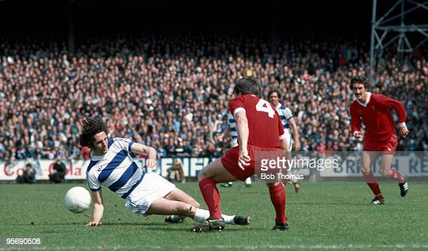 Queens Park Rangers striker Don Givens slides in watched by Liverpool defender Tommy Smith and Terry McDermott during the First Division league match...