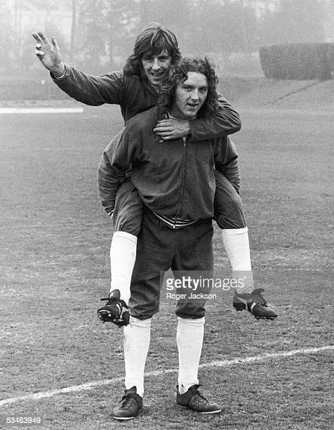 Queen's Park Rangers striker Stan Bowles rides Ipswich Town defender Kevin Beattie around the pitch at Roehampton during training for the upcoming...