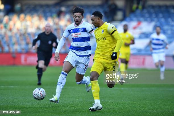 Queens Park Rangers' Zimbabwean striker Macauley Bonne vies with Fulham's Dutch defender Kenny Tete during the English FA Cup third round football...