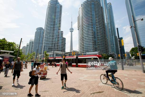 Queens Quay and Bay Street People enjoy the warm weather along Toronto's waterfront