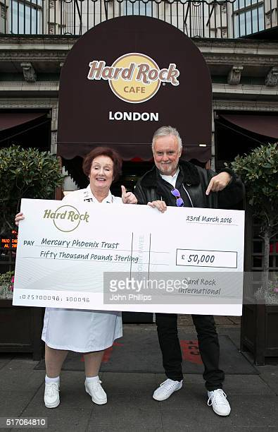 Queen's Roger Taylor accepts a £50000 cheque donated from the Hard Rock Cafe to the Mercury Phoenix Trust at Hard Rock Cafe Old Park Lane on March 23...