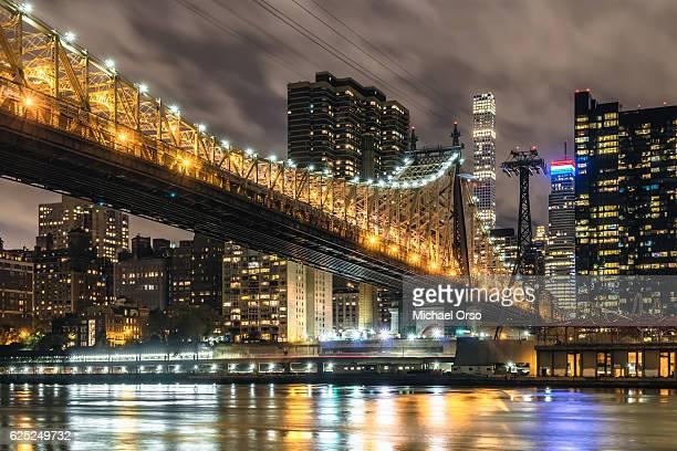 Queensboro RFK 59th Street Bridge. Manhattan NYC skyline at night, viewed for Roosevelt Island. 432 Park Avenue.