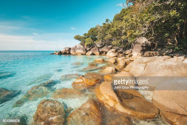queensland beach cairns - cairns stock photos and pictures