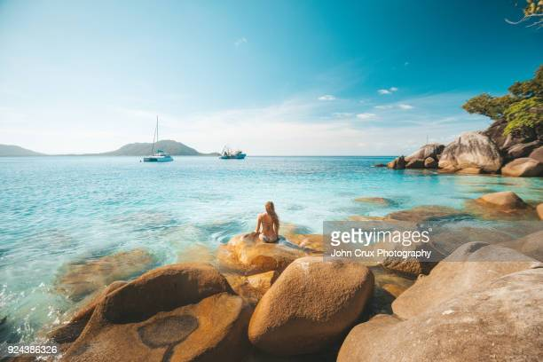 queensland beach girl - idyllic stock pictures, royalty-free photos & images