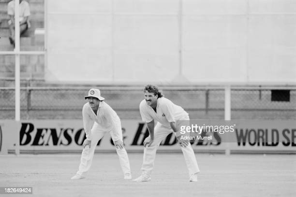 Queensland captain Allan Border with English cricketer Ian Botham also playing for Queensland during a Sheffield Shield match against South Australia...
