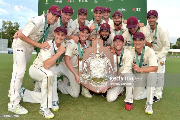 Queensland celebrate after winning the Sheffield Shield final during day five of the Sheffield Shield final match between Queensland and Tasmania at...