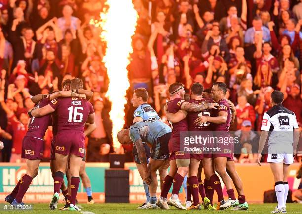 Queensland celebrate victory after game three of the State Of Origin series between the Queensland Maroons and the New South Wales Blues at Suncorp...