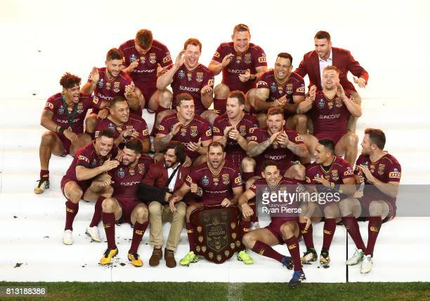 Queensland celebrate with the trophy after game three of the State Of Origin series between the Queensland Maroons and the New South Wales Blues at...