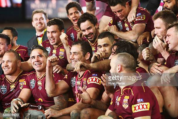 Queensland celebrate with the trophy during game three of the State Of Origin series between the New South Wales Blues and the Queensland Maroons at...