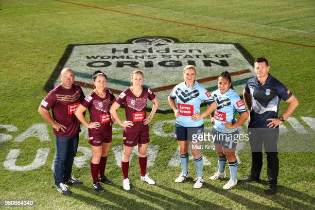 Queensland coach Jason Hetherington Karina Brown and Brittany Breayley of Queensland Ruan Sims and Simaima Taufa of NSW and NSW coach Ben Cross pose...