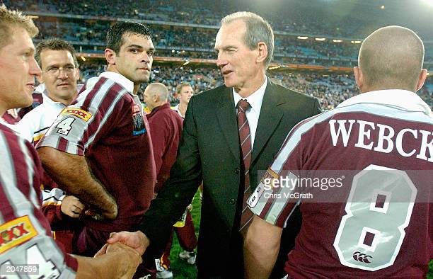 Queensland coach Wayne Bennett congratulates his players after they defended the series during game 3 of the NRL State of Origin series between the...