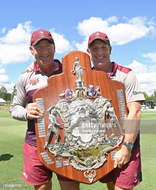 Queensland Coaches Andy Bichel and Wade Seccombe pose for a photo as they celebrate victory during day four of the Sheffield Shield Final match...