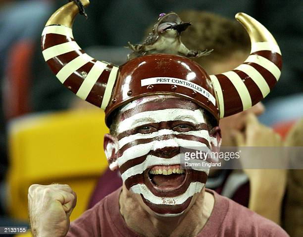Queensland fan cheers on his team during game one of the NRL State of Origin Series between the Queensland Maroons and the New South Wales Blues held...