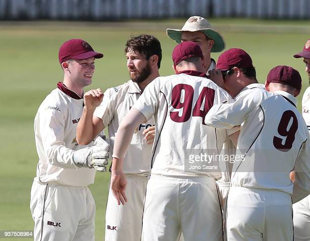 Queensland player Michael Neser celebrates his wicket with team mates during day three of the Sheffield Shield final match between Queensland and...
