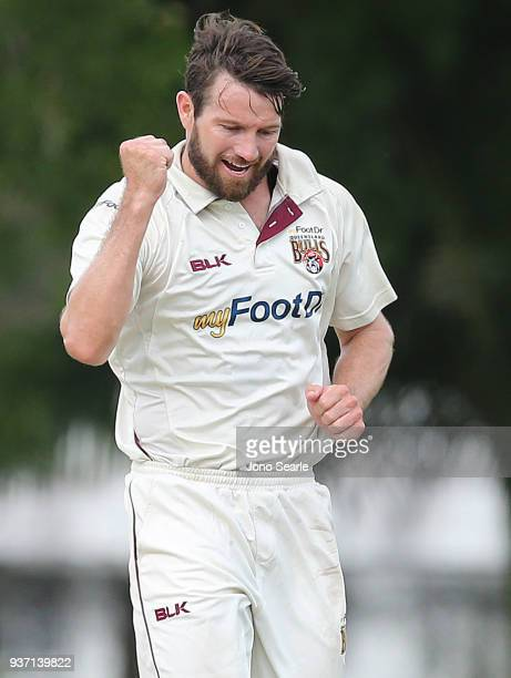 Queensland player Michael Neser celebrates taking a wicket with team mates during day two of the Sheffield Shield Final match between Queensland and...