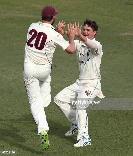 Queensland player Mitch Swepson celebrates as his team mate Michael Neser ran out George Bailey of Tasmania during day two of the Sheffield Shield...