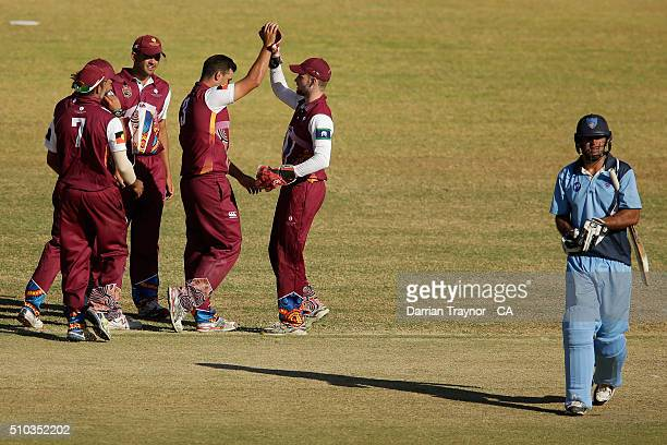 Queensland players celebrate a wicket during the National Indigenous Cricket Championships Final on February 15 2016 in Alice Springs Australia